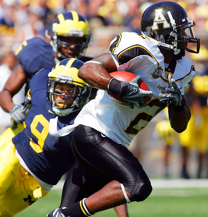 Appalachian State wide receiver Dexter Jackson slips by Michigan safety Anton Campbell as the Mountaineers upset No. 5 Michigan, 34-32.