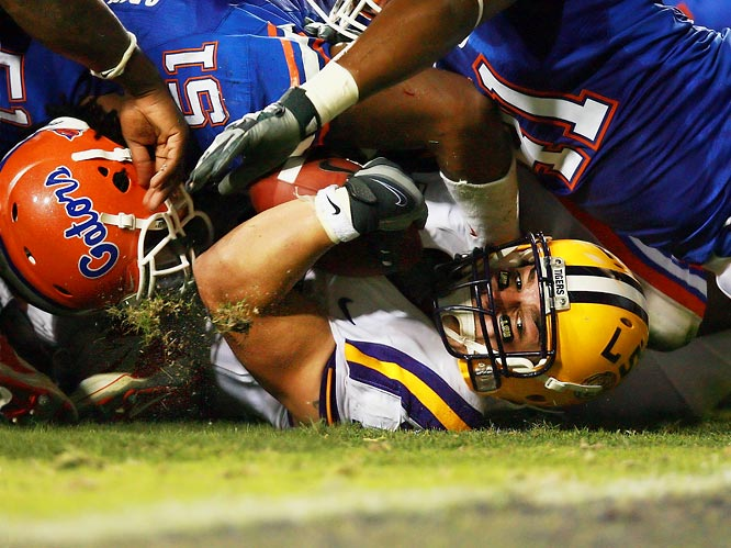 LSU's Jacob Hester eyes the goal line as a pile of Gators hold him just short.