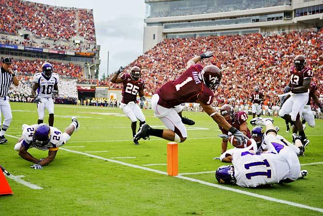 "Virginia Tech's Victor ""Macho"" Harris skies over the goal line and just inside the pylon on an interception return."