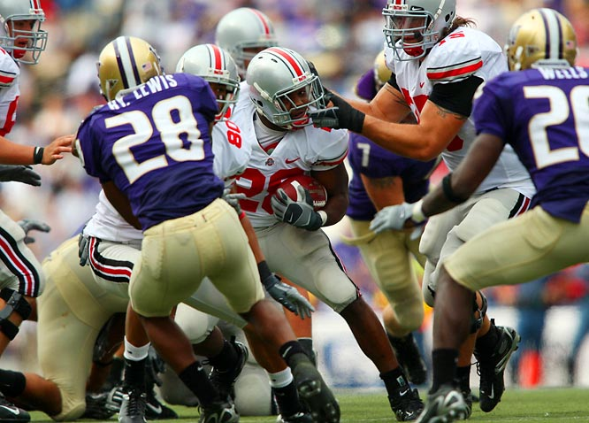 OSU offensive lineman Alex Boone accidentally grabs his teammate, running back Chris Wells, by the face mask.