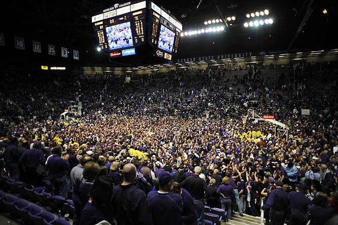 After 24-straight home losses to Kansas, Kansas State fans storm the court after the Wildcats' 84-75 home win over the Jayhawks.