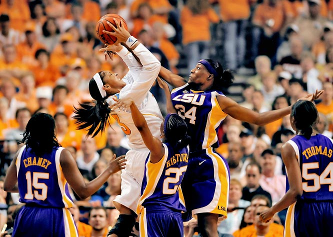 Candace Parker attempts a shot over LSU's Sylvia Fowles (34) and a pack of Tigers in the national semifinal game.