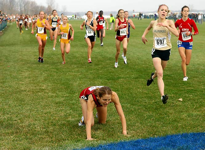 Stanford's Teresa McWalters crawls to the finish line in 43rd place to help the Cardinal win the women's NCAA cross country championships.
