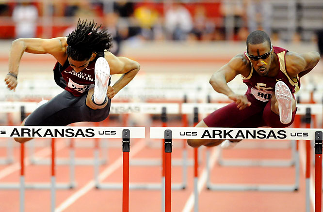 South Carolina's Jason Richardson (left) and Florida State's Drew Brunson stay side-by-side in the 60m hurdles before clocking in together at 7.53 seconds to finish first and second, respectively.