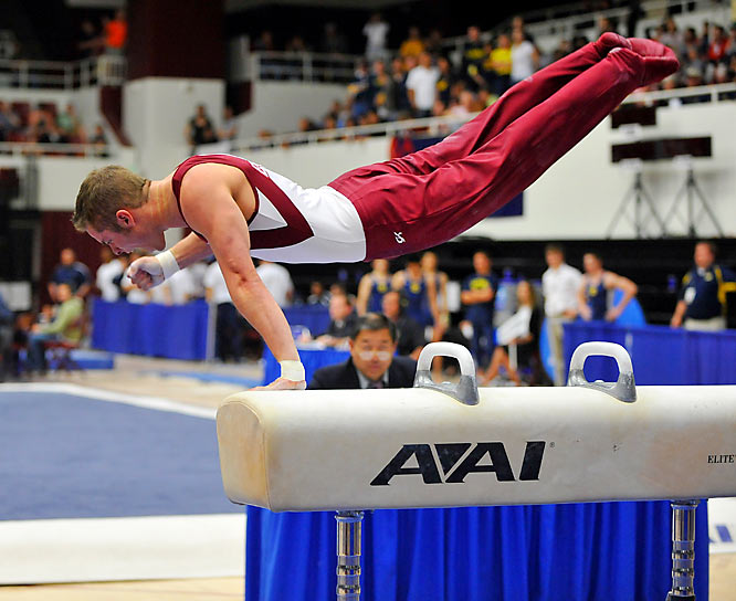 Oklahoma's Corey English celebrates as he finishes his pommel horse routine on the way to a Sooners' national championship.