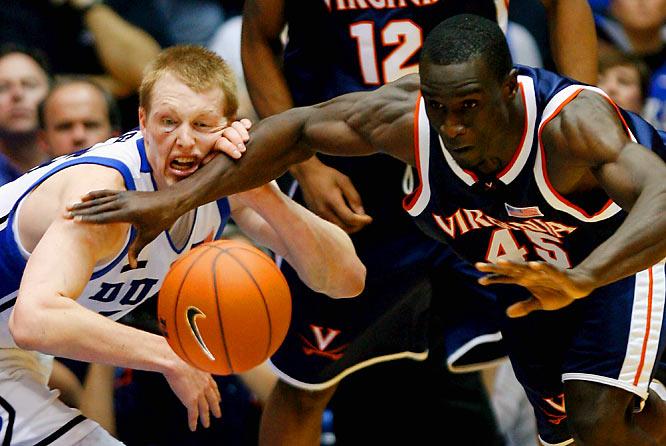 Virginia's Solomon Tat battles Duke's Kyle Singler for the loose ball in the second half of Duke's 87-65 victory.