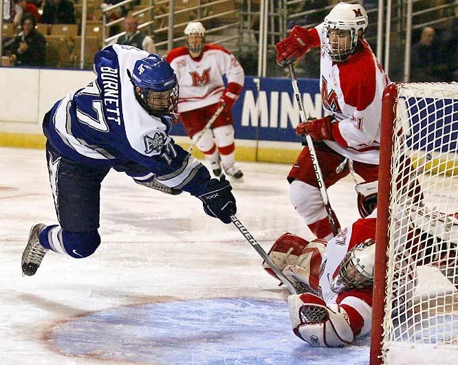 In the second period of a Northeast Regional game, Air Force's Derrick Burnett (17) scores a goal against Miami of Ohio goaltender Jeff Zatkoff (35).