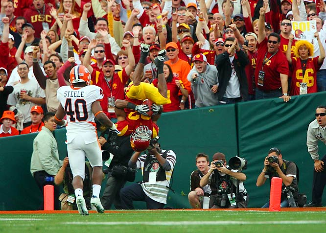 USC senior running back Desmond Reed (22) celebrates with fans after successfully completing a trick play that resulted in an acrobatic front flip into the end zone for the touchdown.