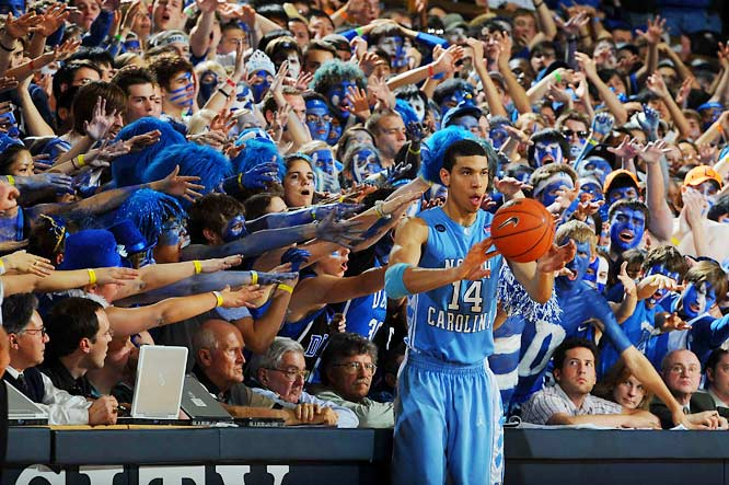 A sea of outstretched Duke fans try to fluster UNC's Danny Green as he inbounds the ball during North Carolina's 76-68 win at Cameron Indoor Stadium.