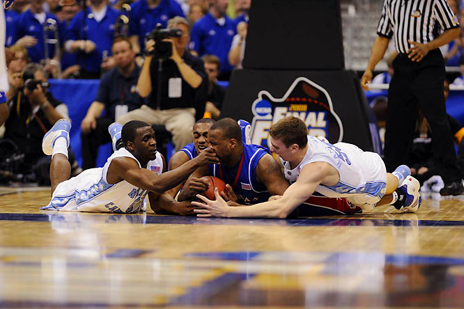 Ty Lawson gives Kansas' Darnell Jackson a nose job as they scramble for the ball with KU's Darrell Arthur and UNC's Tyler Hansbrough during the Jayhawks' 84-66 Final Four win.