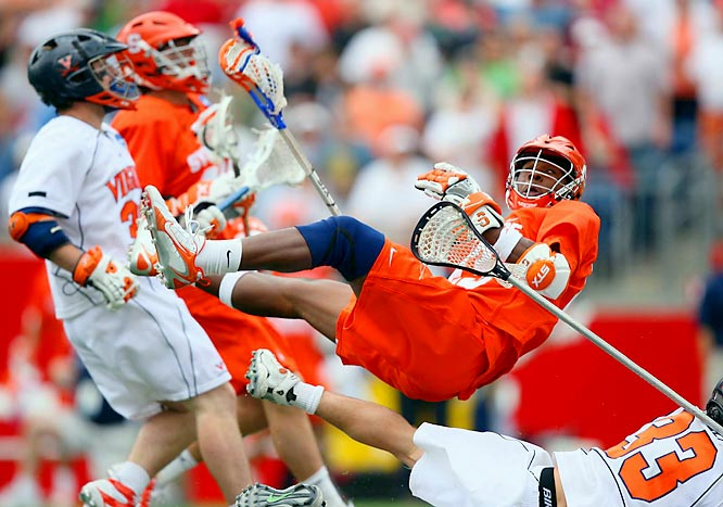 A Syracuse player is knocked off his feet as his team fights back to overcome a 5-goal second half deficit in double overtime.