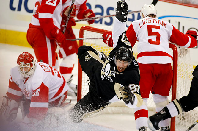Cooking at home, the Penguins improved to 9-0 at Mellon Arena as Sidney Crosby scored their first two goals.
