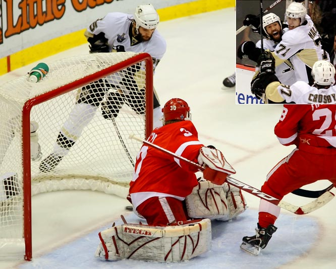 With the Red Wings up 3-2 and only 35 seconds away from hoisting Lord Stanley's mug before a delirious crowd in Joe Louis Arena, Maxime Talbot became an unlikely hero for the Penguins. The fourth-line center was shocked to find himself sent out as an extra attacker in the final minute and ended up stuffing the puck behind Osgood.