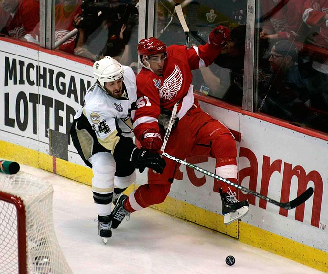 Red Wings center Valtteri Filppula (51) is checked into the boards by Penguins defenseman Brooks Orpik (44) as battle commences in the first period. The Penguins were desperate and on the brink after a tough Game 4 loss at home.