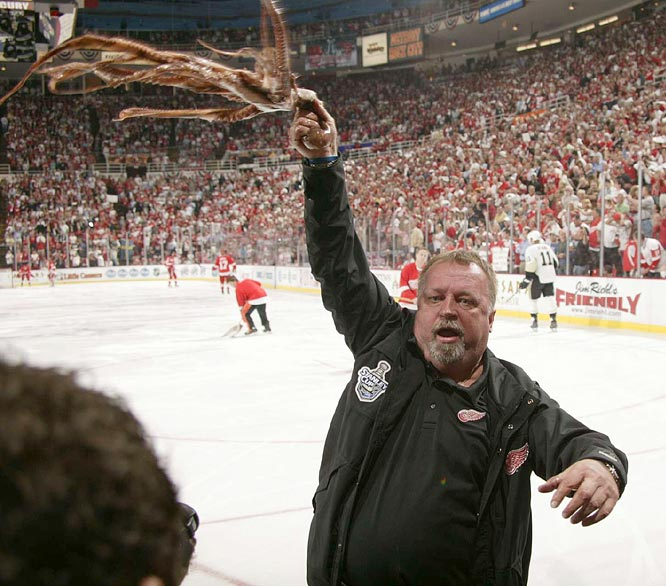 Zamboni driver Al Sobotka waves an octopus that was thrown onto the ice at Joe Louis Arena as the boisterous crowd anticipates the Red Wings winning the 11th Stanley Cup in their storied history.