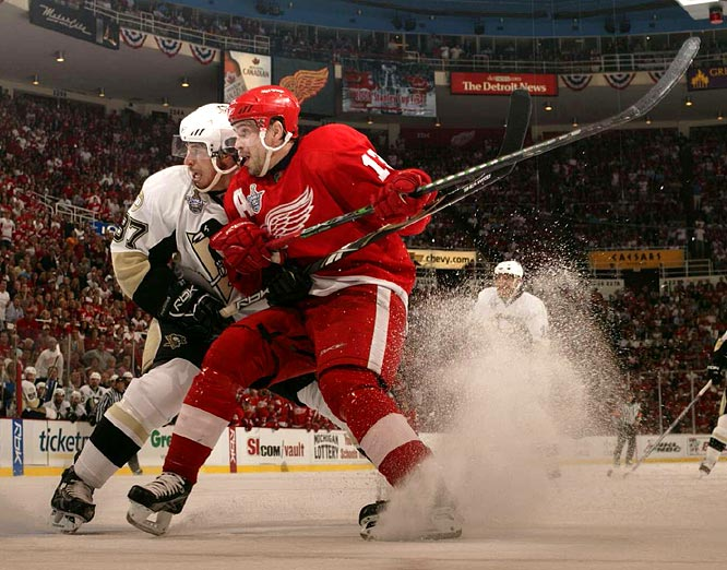 Pavel Datsyuk, who has been extremely effective as a checker in the series, tries to put the clamps on Penguins superstar Sidney Crosby, who assisted on Marian Hossa's opening goal and Maxime Talbot's stunning game-tying tally with only 35 seconds left in regulation.