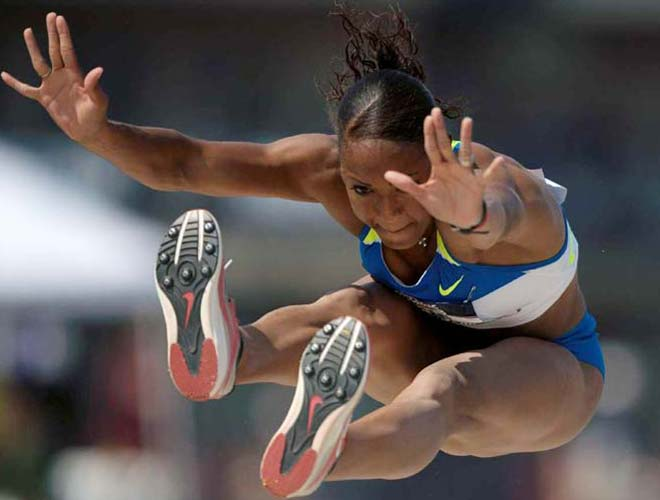 With a triple jump of 47 feet, 2 1/2 inches, Shani Marks punched her ticket to Beijing.