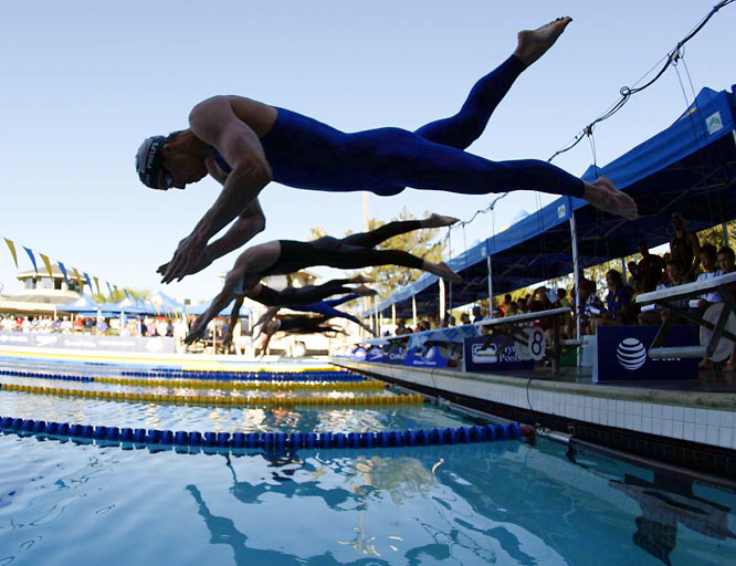 """In the first of seven events he'll swim at the Trials, Michael Phelps broke his own world record in the 400 IM.  Don't be too shocked.  """"Michael is kind of a world-record machine,"""" said longtime teammate Katie Hoff."""