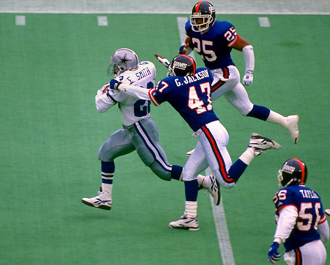 Halftime X-rays revealed that Smith had separated his shoulder in the second quarter, when Giants safety Greg Jackson tackled the running back from behind. But Smith came back to rush for 59 yards on 13 attempts, leading Dallas to a 16-13 overtime win that clinched the NFC East title, home-field advantage in the playoffs, and, for Smith, a third-consecutive rushing title.
