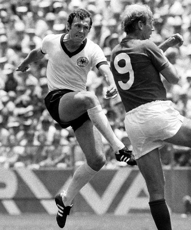 In a 1970 World Cup semifinal against Italy, Beckenbauer (left) suffered a fractured clavicle and played the remainder of the game with his dislocated arm in a sling.