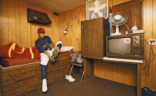 "This is lodging, Alaska-style: A number of Goldpanners players, including Lewis-Clark State pitcher Kevin Camacho (pictured), spent their 2007 summer living in trailers next to Growden rather than with host families. Goldpanners GM Don Dennis purchased the trailer park, nicknamed the ""Olympic Village,"" from the Trans-Alaska Pipeline Company in 1986 and had it moved from Atigun Pass (300 miles to the north) to an asphalt lot adjacent to left field."