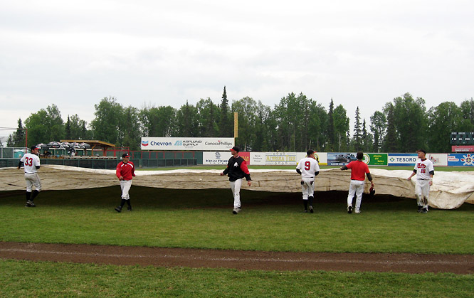 Tarps come in handy in volatile Alaskan weather, especially in Kenai, where Oilers players were enlisted in grounds-crew work after games at Coral Seymour Park. The Oilers, who count J.D. Drew, Mark Teahen and Doug Mientkiewicz among their list of MLB alums, finished tied for third in the 2007 ABL standings.