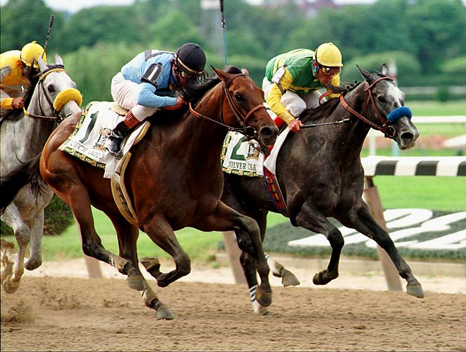 """He will win the Triple Crown, I guarantee it,"" jockey Gary Stevens said of Silver Charm (right) after winning the first two legs by a head and a nose, respectively. Into the Belmont homestretch, the guarantee looked good, but Touch Gold ran down Silver Charm and won by a half-length."