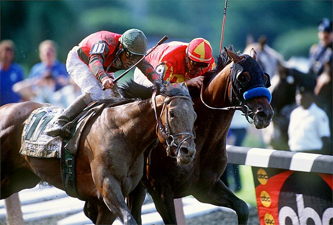 Real Quiet (right) had held off charges from Victory Gallop (left) in both the Derby and Preakness, but Bob Baffert's second straight Triple Crown contender lost a six-length lead in the stretch in a photo finish.
