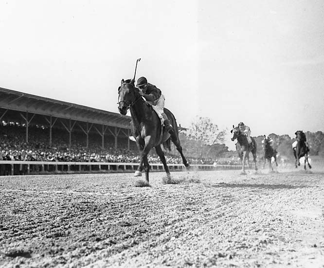 Eddie Arcaro became the first and only jockey to win two Triple Crowns (he won in 1941 with Whirlaway) after winning all three races by more than three lengths and tying the then-Belmont Stakes record of 2:28.2.