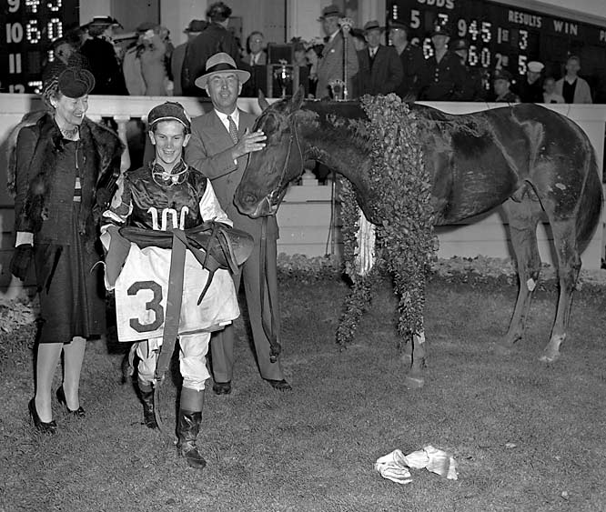 """Despite a deformed right hoof and noticeable limp, earning him the nickname """"The Clubfooted Comet,"""" Assault came from five lengths back in the stretch to win the Belmont, and the Triple Crown, by three lengths."""