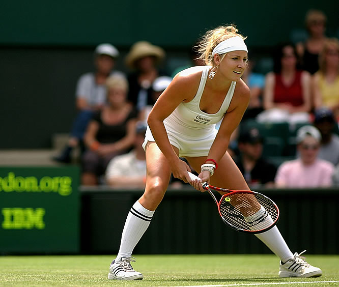 The Lady Gaga of tennis wears her famous high football socks while competing against equally trendy Venus Williams.