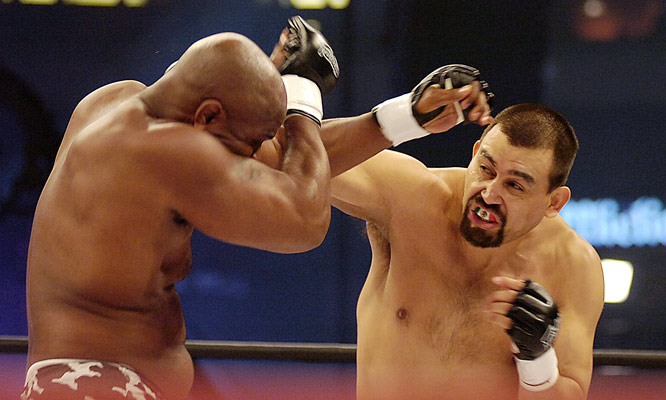 Originally scheduled to fight Aleksander Emelianenko, who was scratched from the card after failing to meet licensing requirements, Paul Buentello (facing) managed to overcome replacement Gary Goodridge by unanimous decision.