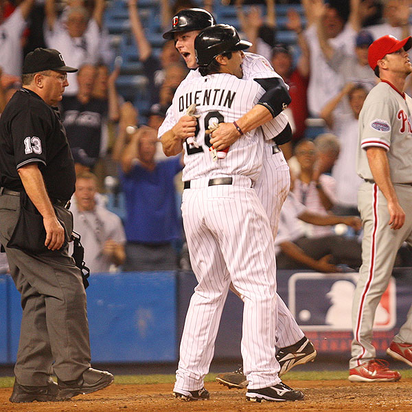 It took 15 innings, but the American League ran its unbeaten string to 12 when Justin Morneau scored on Michael Young's sacrifice fly for a 4-3 win. It was enough to make the Twins' Morneau give Carlos Quentin of the rival White Sox a big hug.