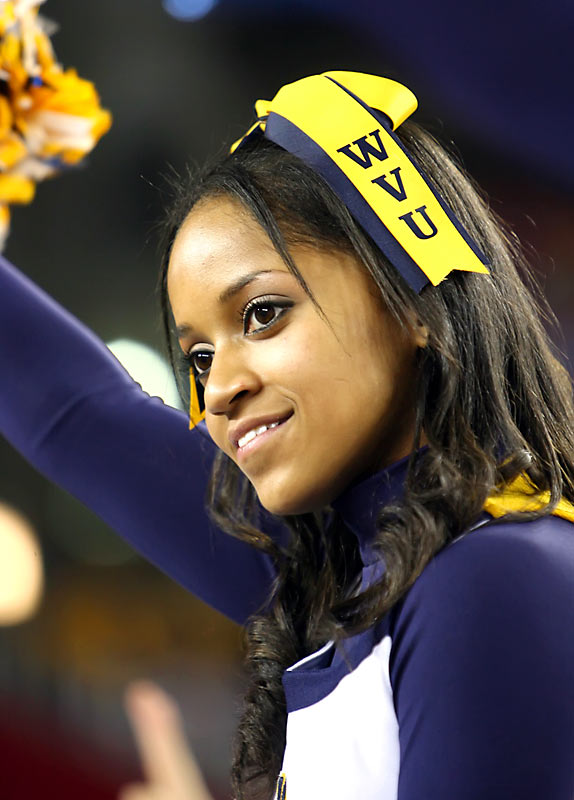 Meet Kendra, a sport management student and member of the West Virginia cheer team. The proud Mountaineer loves talking football, has a weakness for junk food and hates wearing dresses. Want to find out more? Click on the 20 Questions link below.