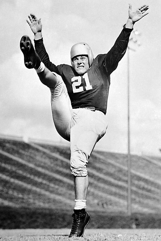"1942 belonged to Frankie Sinkwich. That year he led Georgia to an 11-1 record, including a Rose Bowl victory over UCLA. He won the Heisman Trophy, becoming the first player from the SEC to receive the prestigious award. Sinkwich was also voted the ""No. 1 athlete of 1942"" by the Associated Press. Sinkwich won in a landslide, ahead of Boston Red Sox outfielder Ted Williams, who hit for the Triple Crown that season."