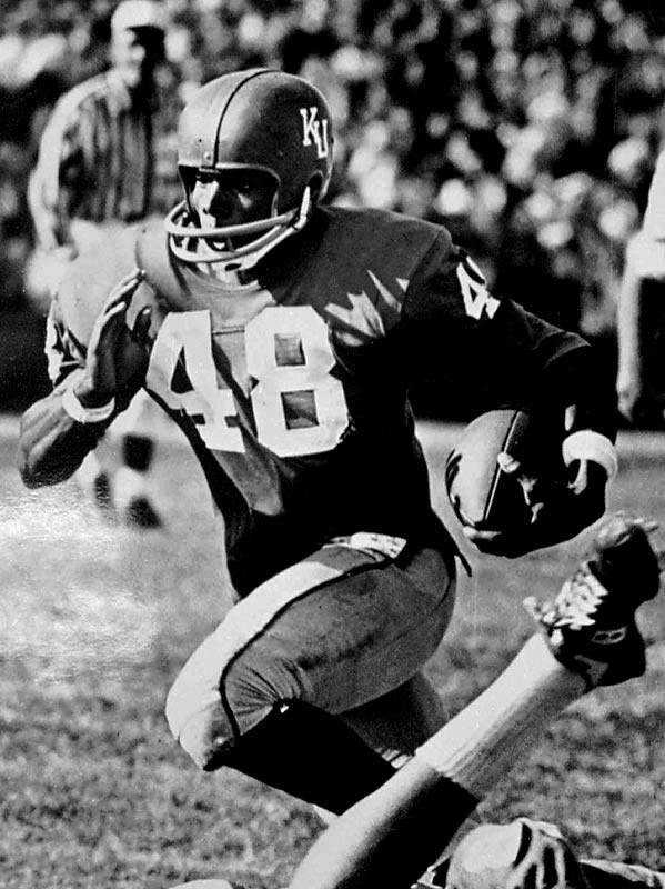 "Known as one of the greatest open field runners in college football history, Gale ""Kansas Comet"" Sayers was a two-time All-America running back who finished his career with 2,675 rushing yards and 3,917 all-purpose yards. Sayers also ran track for the Jayhawks, competing in the hurdles, 100-m, and long jump. Drafted fourth overall, Sayers became a Pro Bowl running back for the Chicago Bears and is a member of the College and Pro Football halls of fame."