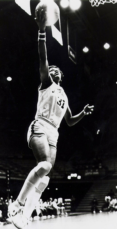 A four-time All-America basketball player, Lynette Woodward set a record as the top-scoring women's college basketball player in NCAA history, averaging 26 points per game and scoring 3,649 total points. She went on to win an Olympic gold medal in 1984 and became the first female member of the Harlem Globetrotters before playing overseas and eventually being drafted in the WNBA.