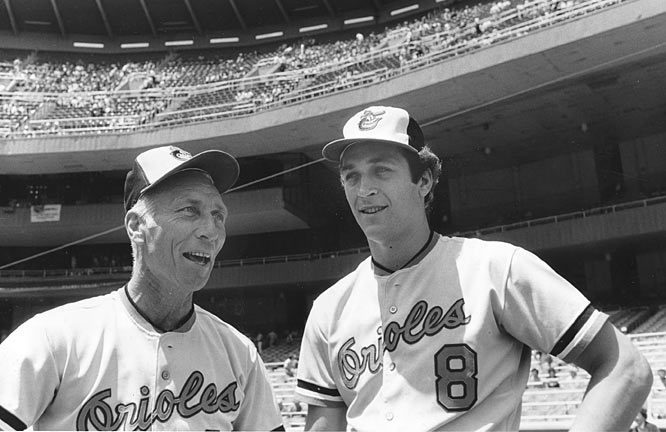 Cal Ripken Jr. (seen here with his father, Cal Ripken Sr.) plays his first major league game.