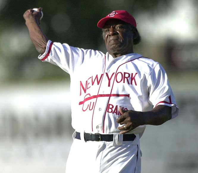 At the age of 77, Minnie Minoso becomes the first player to play professional baseball in seven decades. The Cuban native, who had a 16-year big league career which ended in 1964, walks as the designated hitter for the St. Paul Saints against Gary SouthShore RailCats in independent Northern League action.