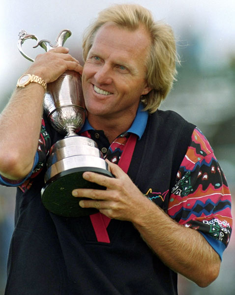 Greg Norman captures his third career British Open by shooting a 267 at Royal St George.