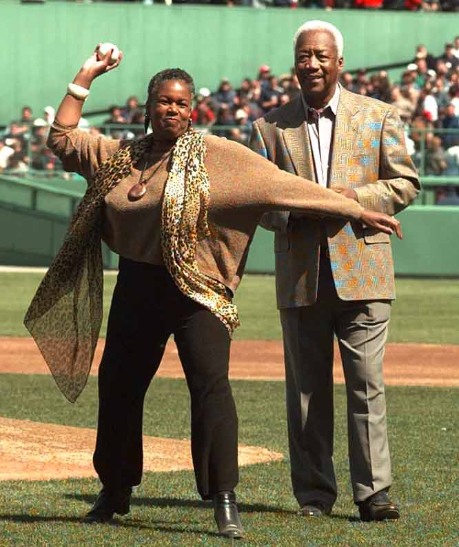Elijah 'Pumpsie' Green (pictured here with Sharon Robinson, daughter of Jackie Robinson) pinch runs and plays shortstop to become the first black to play for the Red Sox.