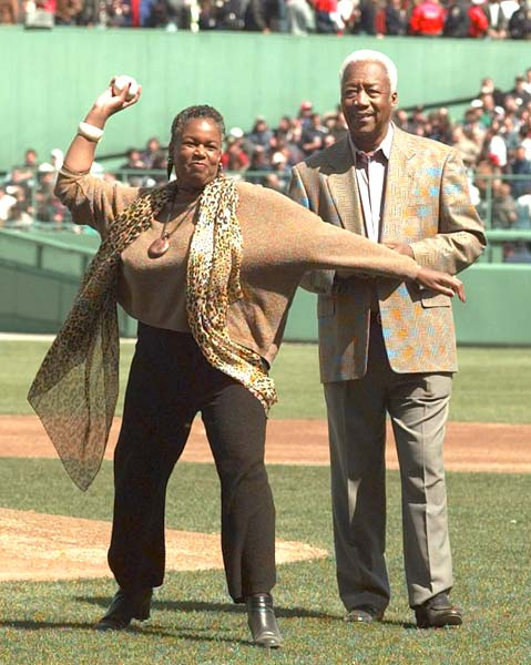 After mysteriously disappearing off the team bus in New York two days ago with teammate Gene Conley to use the rest room, infielder Pumpsie Green (pictured here with Sharon Robinson, daughter of Jackie Robinson) returns to the Red Sox and is fined.