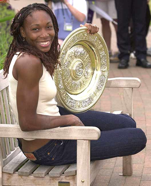 Venus Williams wins her second of five Wimbledon titles with a victory over Justine Henin.