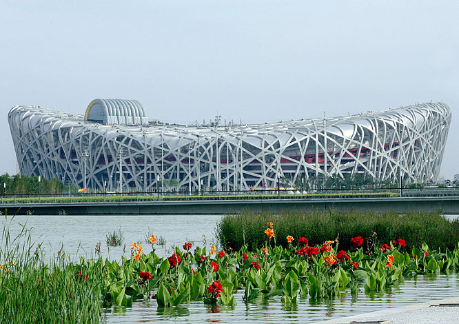 "Pritzker Prize-winning architects Herzog & de Meuron collaborated with ArupSport and China Architecture Design & Research Group to design the stadium, which will host the opening and closing ceremonies, the track and field competitions and the soccer tournament. Nicknamed the ""Bird's Nest,"" the 93,000-seat arena was built with 36 kilometers of unwrapped steel weighing 45,000 tons."