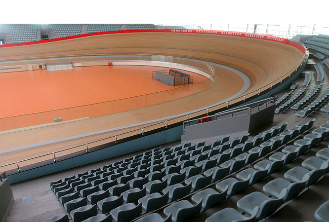 The state-of-the-art Laoshan Velodrome has a capacity of 6,000 spectators and a 250-meter oval shaped surface for the track cycling events.
