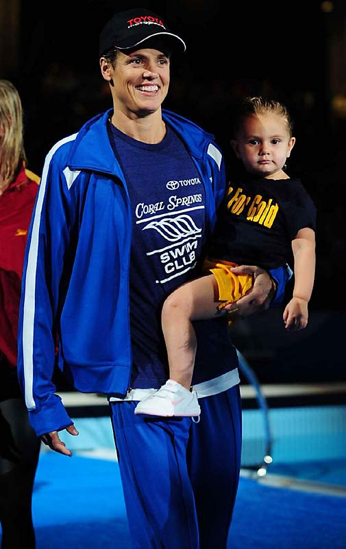 Dara Torres holds her daughter, Tessa, after setting an American Record of 24.25 in the 50-meter freestyle final..