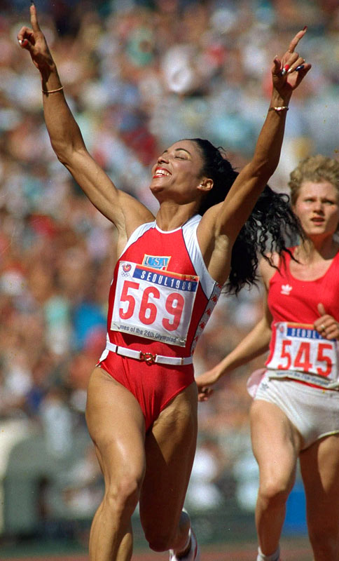 "Still the ""World's Fastest Woman,"" with world records in both the 100 and 200 meters, Griffith-Joyner won three gold medals in 1988 with her red, white, and blue painted fingernails."