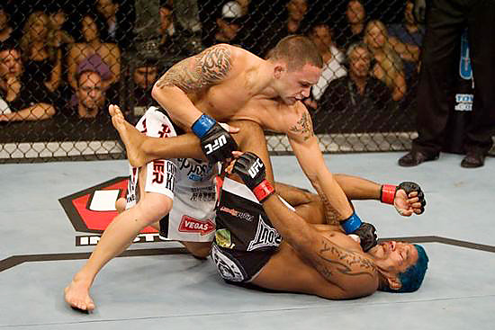 In his return bout from a steroid suspension that kept him out of the Octagon since UFC 73, Hermes Franca (bottom) failed to retaliate against the multiple takedowns and punches from Frank Edgar. The judges voted unanimously in favor of Edgar.
