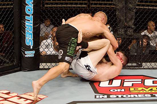 With a nasty cut over his left eye, Nate Loughran (white trunks) held Johnny Rees in two triangle chokes before a third was so deep that Rees' hips were twisted and he had to tap out at 4:21 in the first.