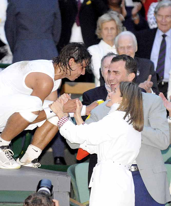 Native son Rafael Nadal accepts congratulations from Spain Prince Felipe and Princess Letizia after his first Wimbledon title.